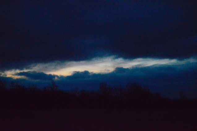 I watched as the dark clouds over took dawn